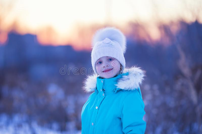 Beautiful little girl in a frosty day royalty free stock photography
