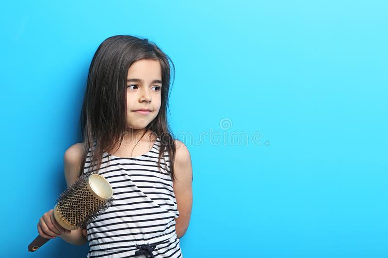 Little girl with hair comb stock image