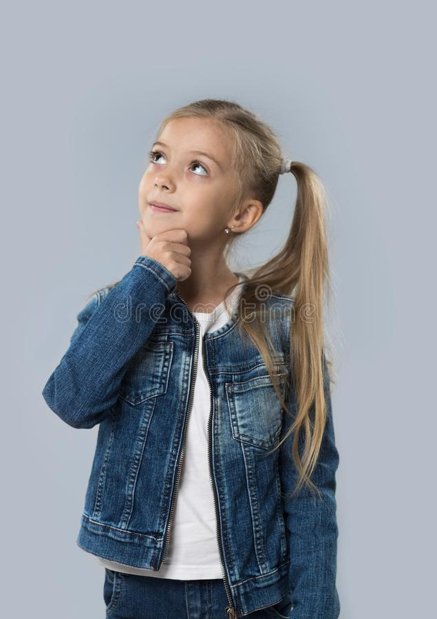 Beautiful Little Girl Happy Smiling Wear Jeans Coat Isolated Looking Up To Copy Space royalty free stock image