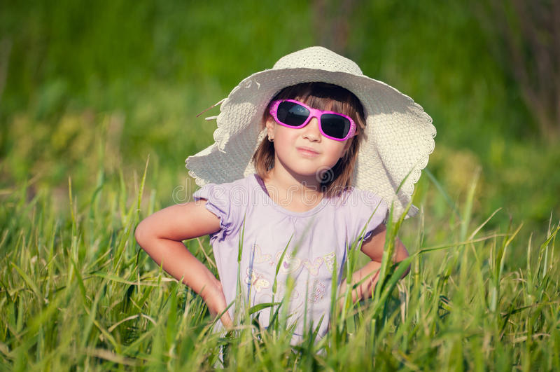 A Beautiful Little Girl With A Hat In A Grain Fiel Stock Photo