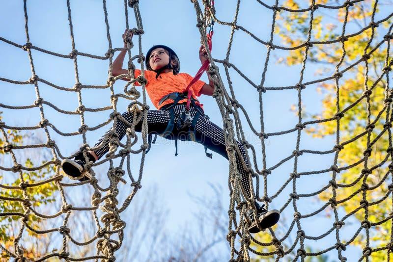 Beautiful little girl having fun in adventure Park, Montenegro stock photos