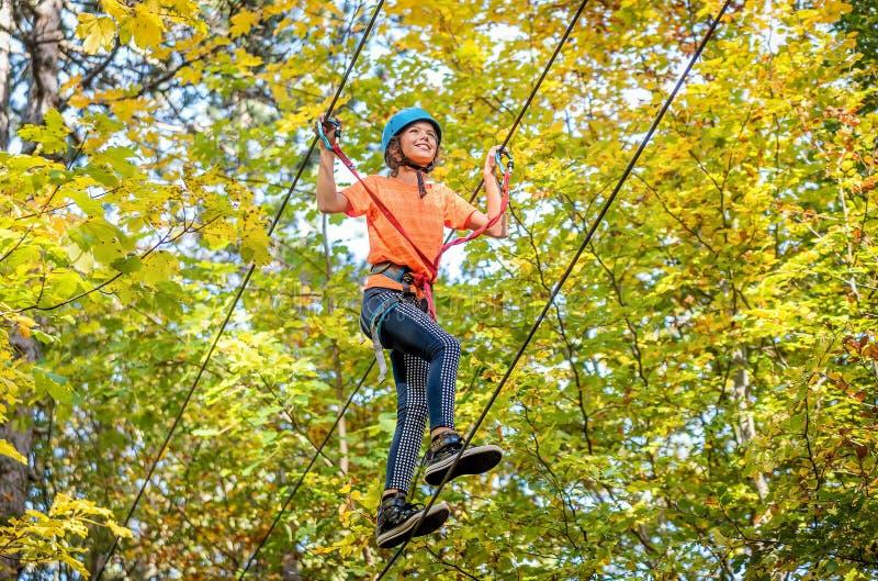 Beautiful little girl having fun in adventure Park, Montenegro royalty free stock images