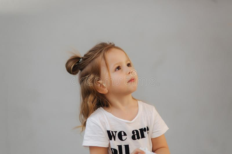 Beautiful little girl having fun in the city. we are all kids stock image