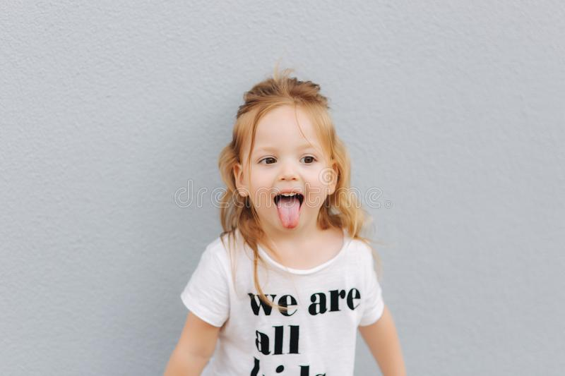 Beautiful little girl having fun in the city. we are all kids royalty free stock photography