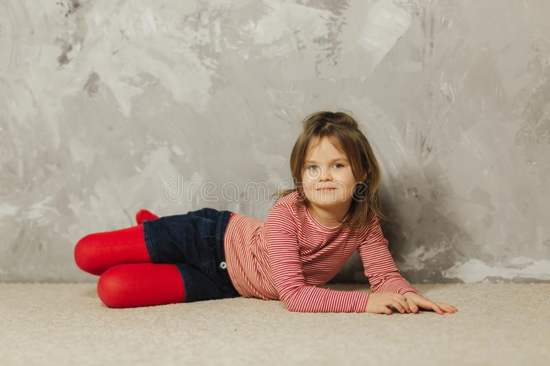 Beautiful little girl having fun at home. Five year old girl play at home royalty free stock images