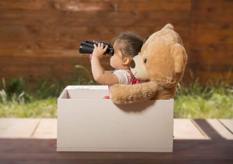 Beautiful little girl having fun playing outdoors stock image