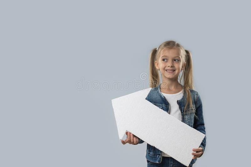 Beautiful Little Girl Hold Arrow Copy Space Happy Smiling Wear Jeans Coat Isolated stock photography