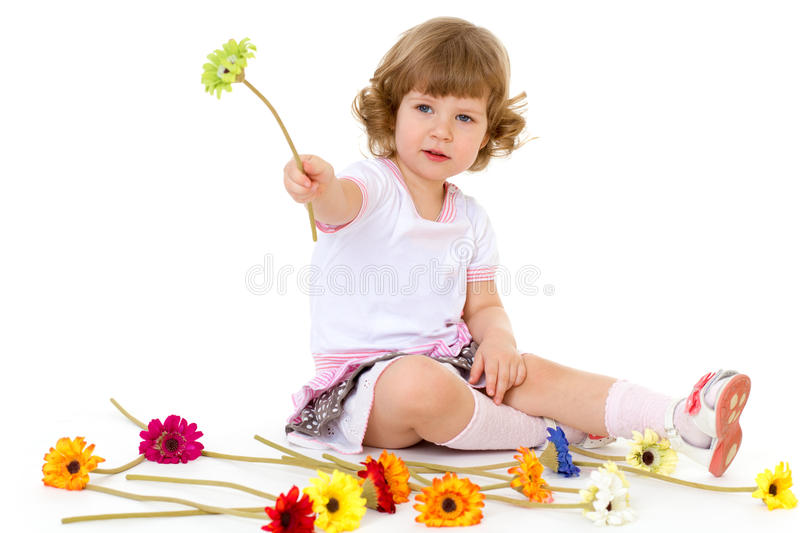 Beautiful little girl in holding a bouquet. stock photos