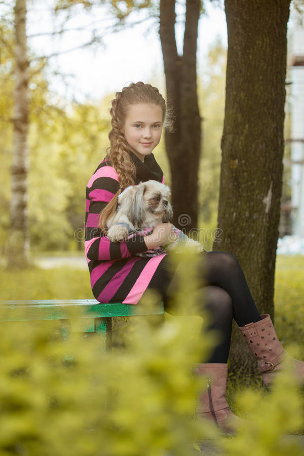 Beautiful little girl holding cute puppy. Close-up royalty free stock photography