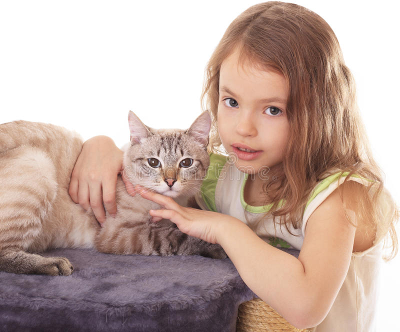 Beautiful little with cat. Beautiful little girl hugging her cat stock photography