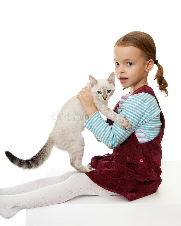 Download Beautiful Little Girl With A Kitten. Stock Photo - Image of thai, home: 16652340