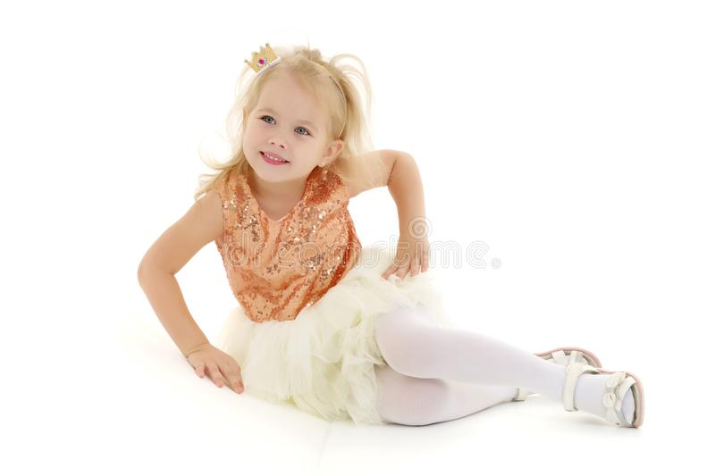 Little girl lies on the floor stock images