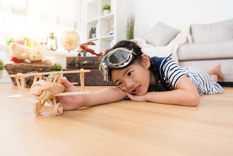 Beautiful little girl lying down on floor resting stock photos