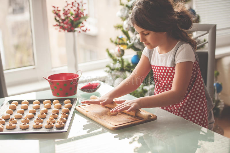 Beautiful little girl making homemade cookies for Christmas royalty free stock photography
