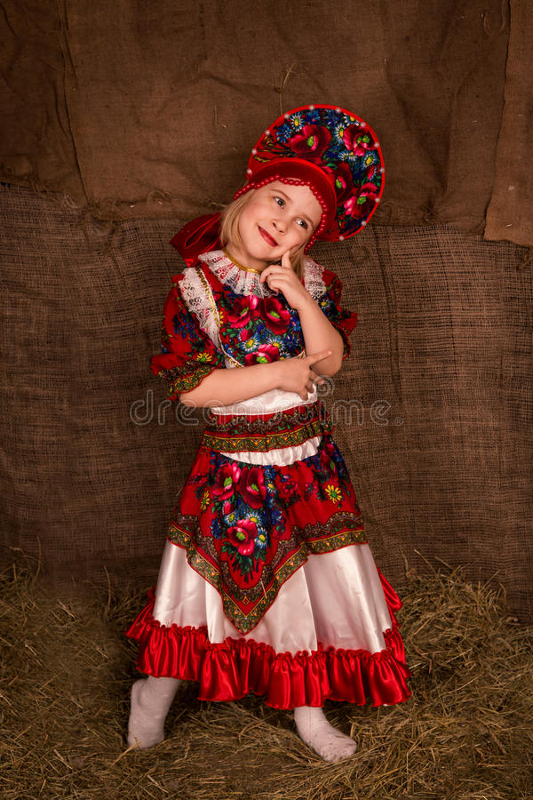 Beautiful little girl in national costume. Dancing stock image