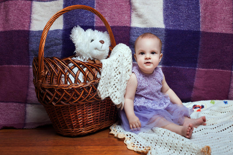 Beautiful little girl near a basket royalty free stock images