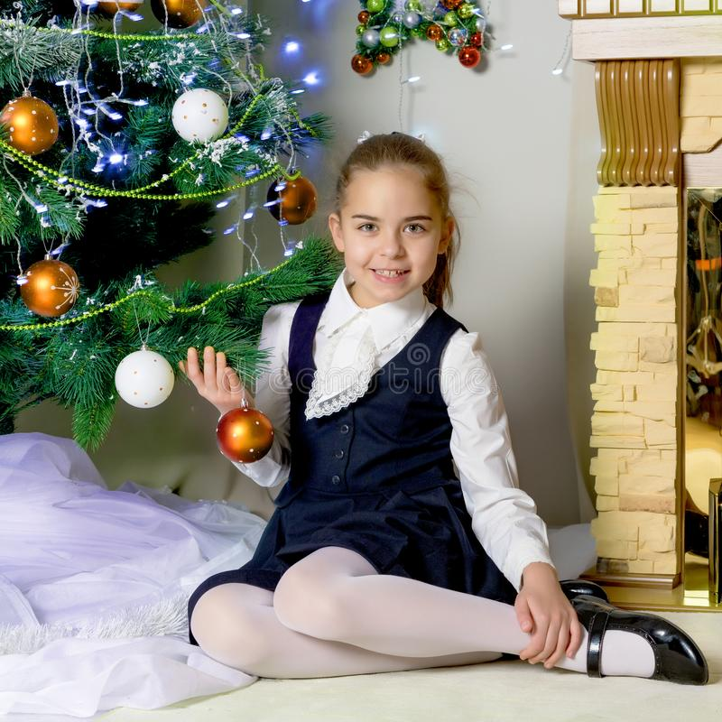Little Girl Christmas Tree: The Girl At The Christmas Tree. Stock Image