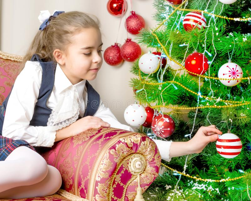 The girl at the Christmas tree. royalty free stock photo