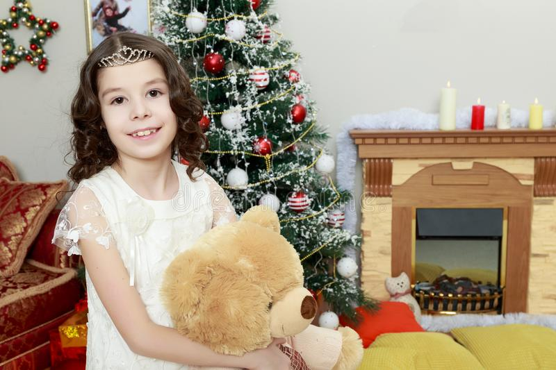 Girl with a Teddy bear. royalty free stock photography