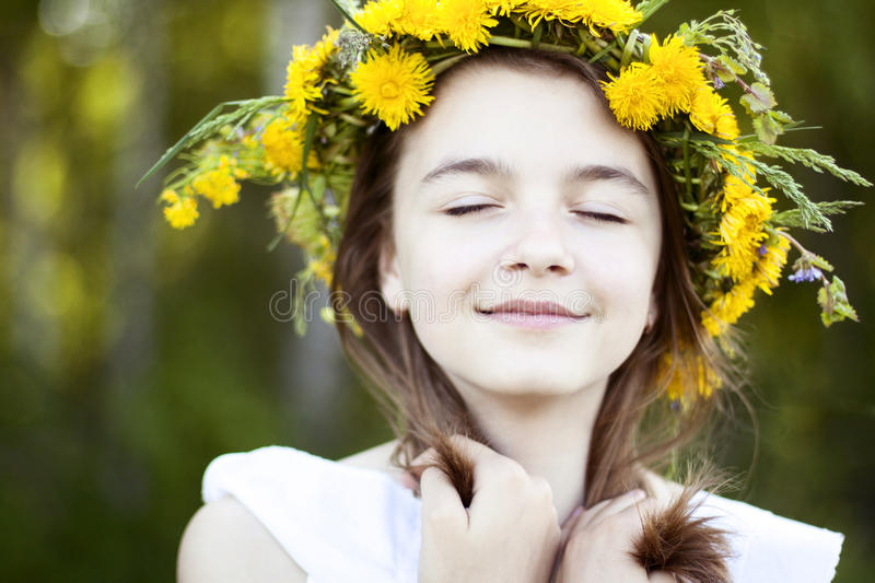 Beautiful little girl, outdoor, color bouquet flowers, bright sunny summer day park meadow smiling happy enjoying life stock photography