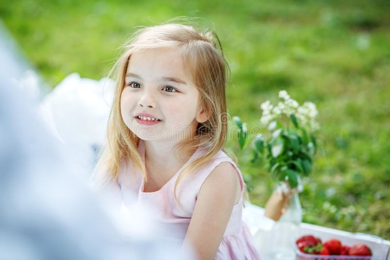 Beautiful little girl in the park. A child is 4 years old. Summer. Concept of lifestyle, game and childhood. stock image