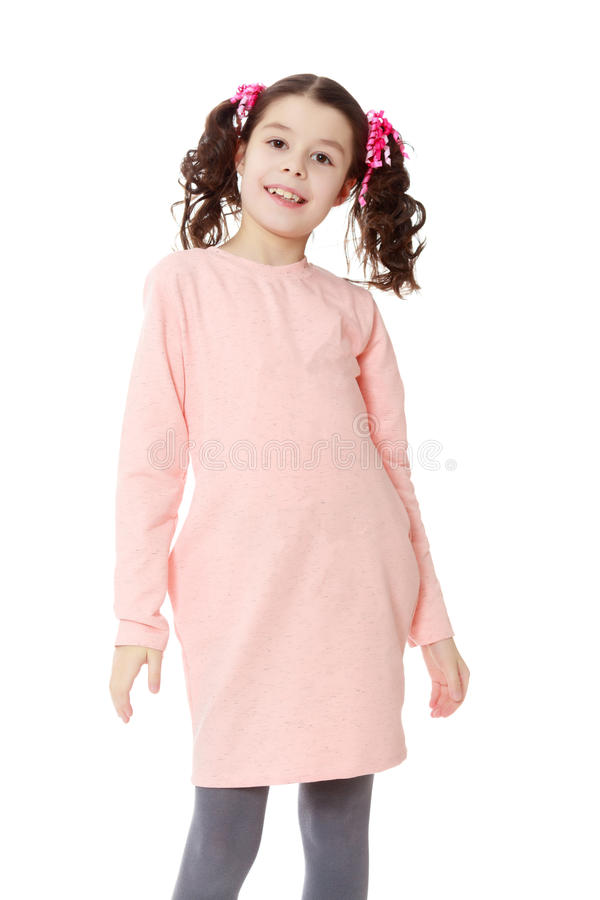 Beautiful little girl in a pink dress. stock photo