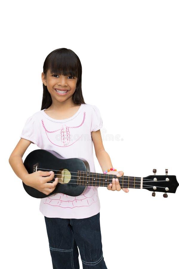 Beautiful little girl playing guitar stock photo