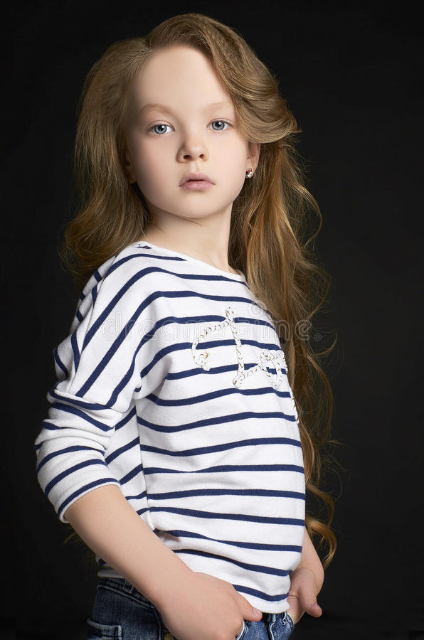 Beautiful little girl portrait. Fashion child model with long hair royalty free stock image