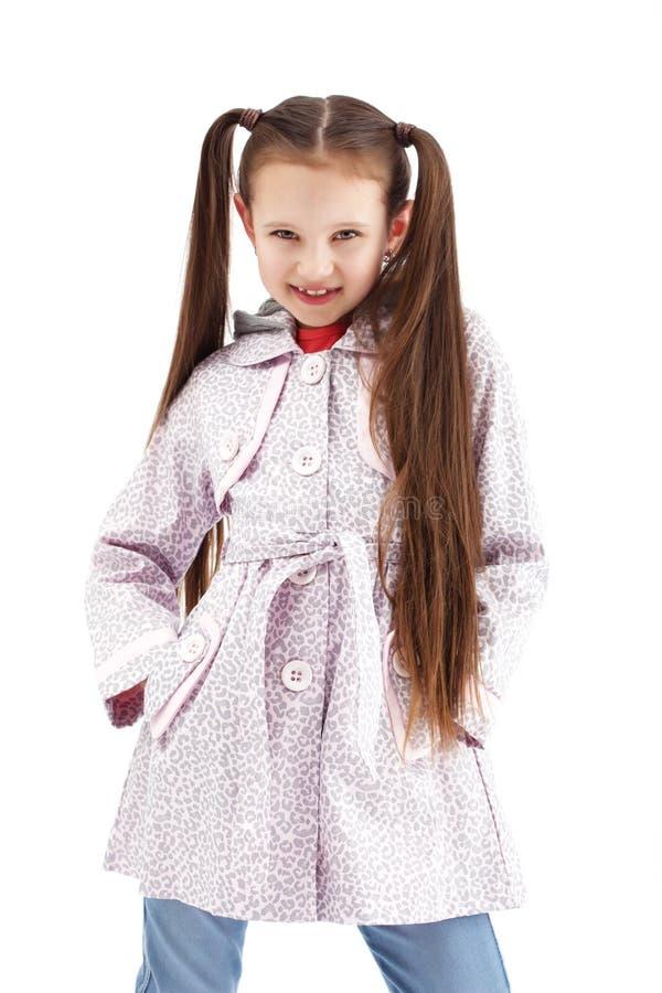 Beautiful little girl posing in fashionable coat stock image