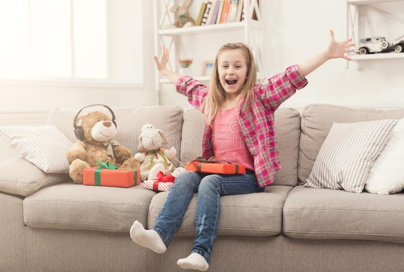 Beautiful little girl with presents at home stock images