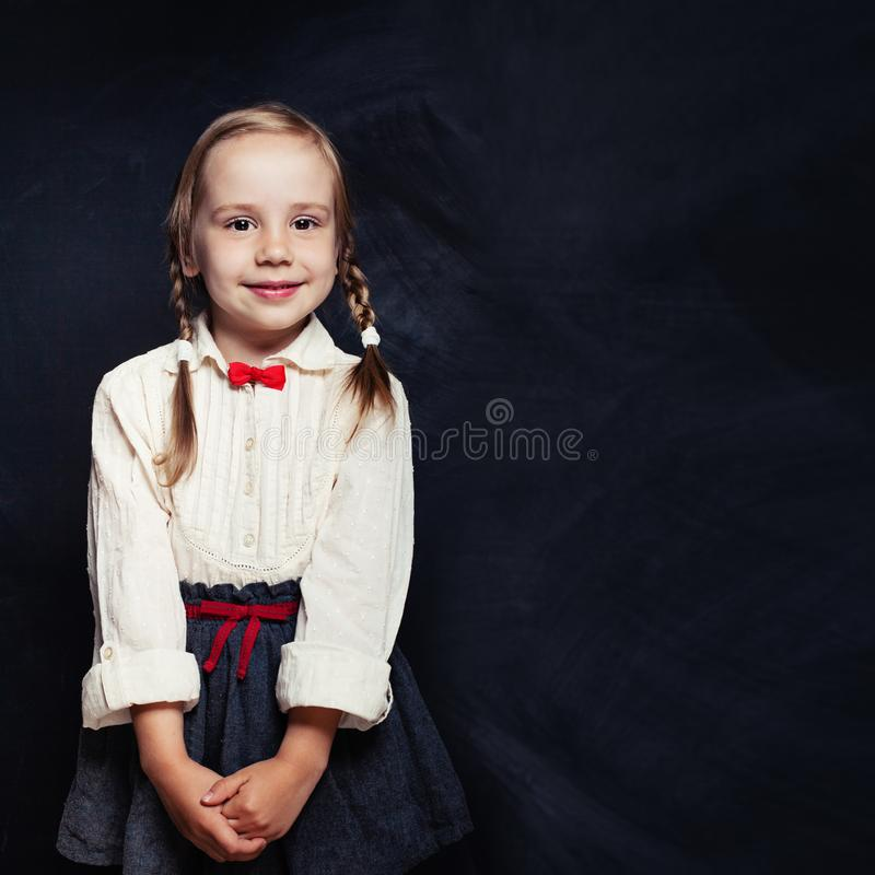 Beautiful little girl in primary school uniform. Happy child stock images