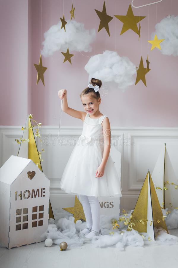 Beautiful little girl in princess dress with long hair stock photography