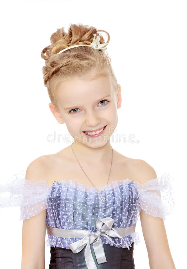 Beautiful little girl in Princess dress. Slender little girl , with beautiful hair on his head,elegant long Princess dress.Girl smiling at the camera. Close-up royalty free stock photos