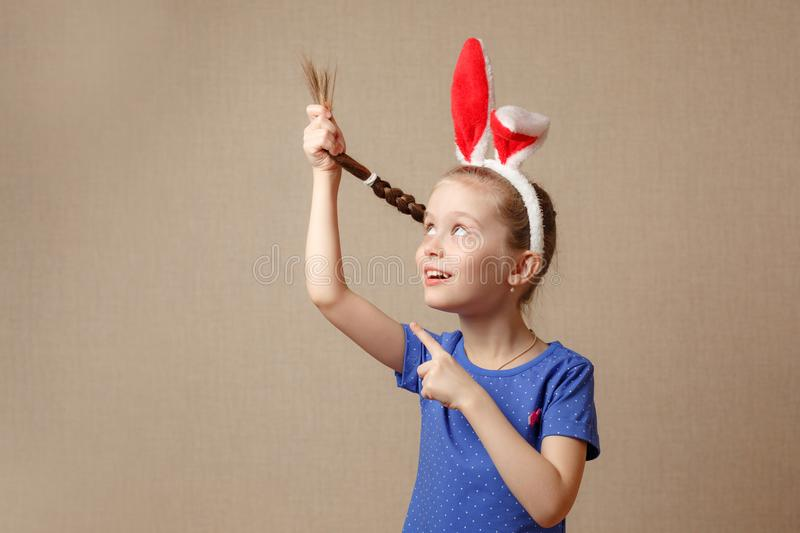 Beautiful little girl dressed in Easter bunny ears on a vintage background royalty free stock images