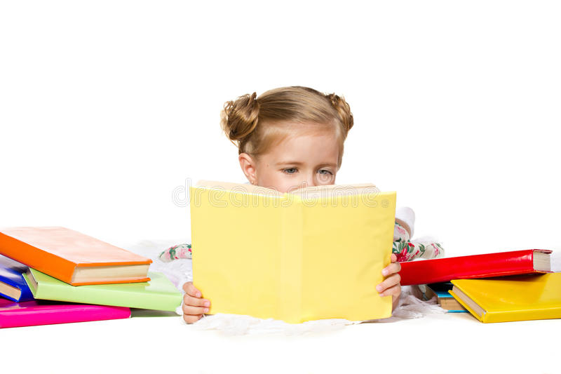 Beautiful little girl reading the book royalty free stock images