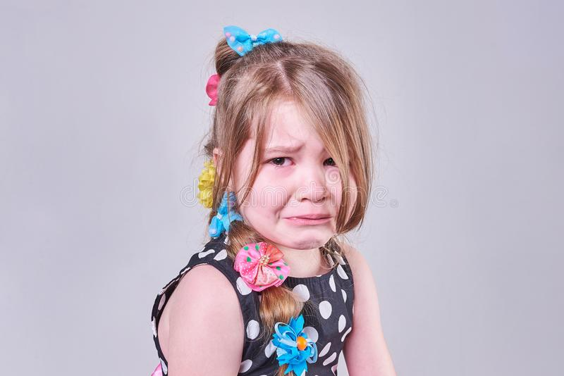 Beautiful little girl, with a sad expression and tears in her eyes royalty free stock images