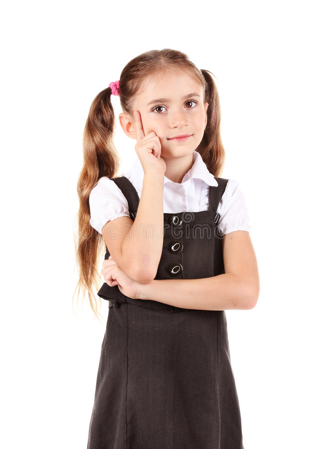 Beautiful little girl in school uniform stock photos