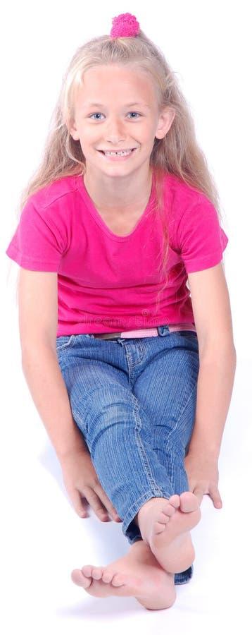 Beautiful little girl sitting stock photos