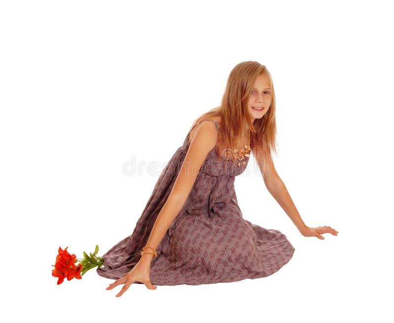 Beautiful little girl sitting on floor. royalty free stock photography