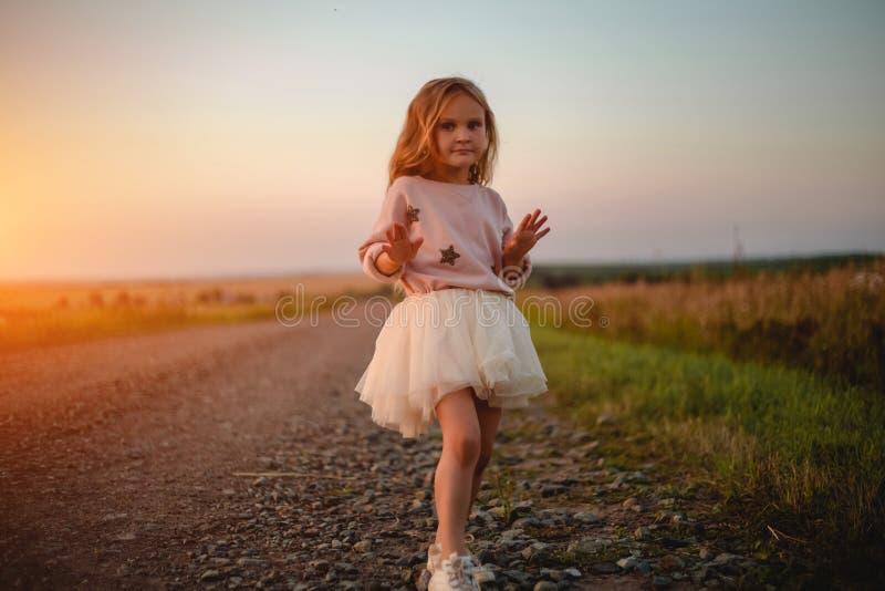 Beautiful little girl in skirt stock photography