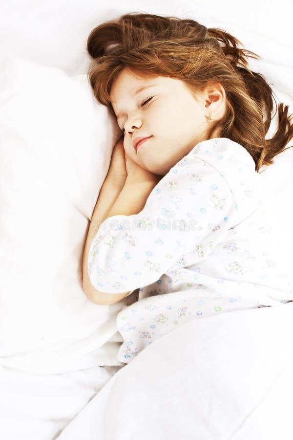 Beautiful little girl sleeping stock photo