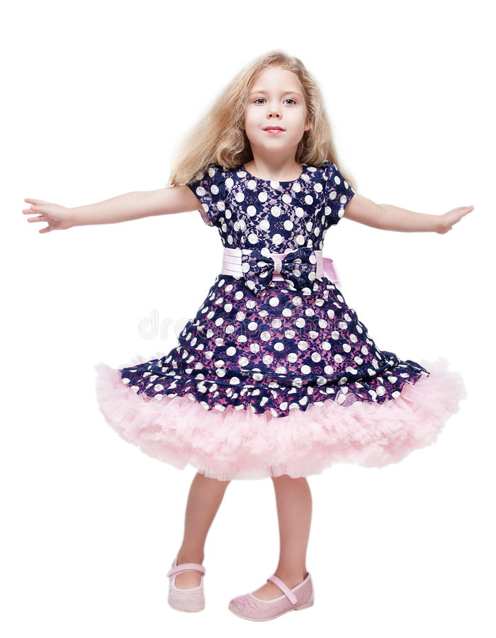 Beautiful little girl spinning around isolated royalty free stock images