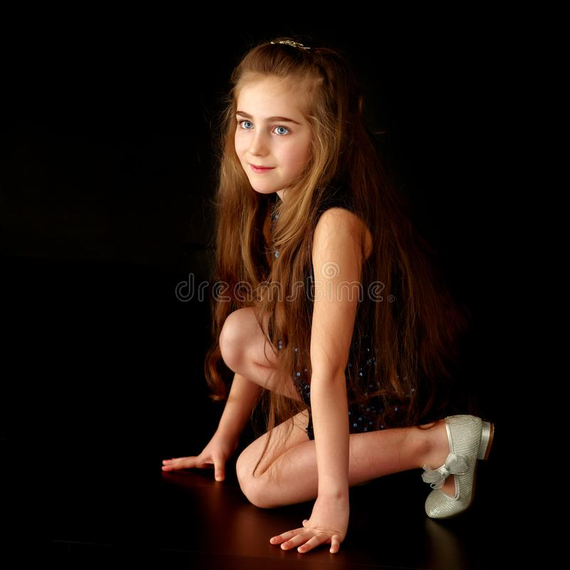 Beautiful little girl, studio portrait on a black background. royalty free stock images