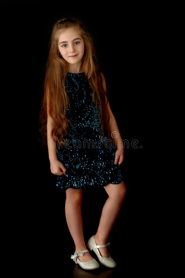 Beautiful little girl, studio portrait on a black background. royalty free stock photo
