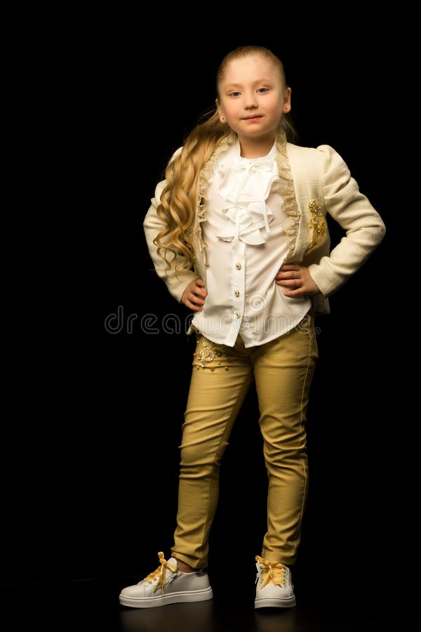 Little girl on a black background stock photo