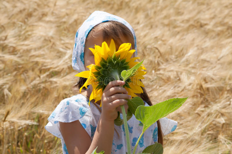 Download Beautiful Little Girl And Sunflower Stock Photo - Image of cute, baby: 39511706