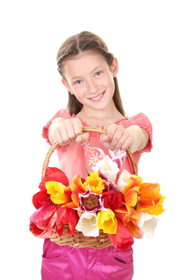 beautiful little girl with tulips in basket