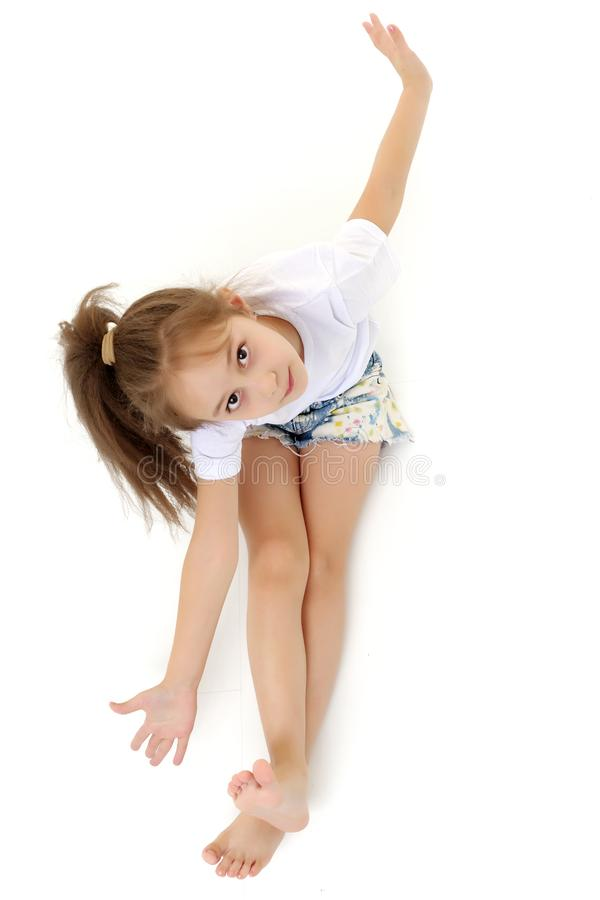 Beautiful little girl view from above. stock photography
