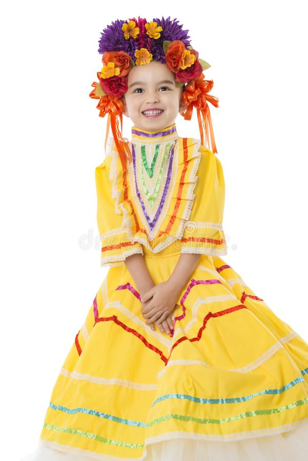 Traditional Mexican dress and hair piece. Beautiful little girl wearing colorful traditional Mexican dress and hair piece, white background royalty free stock photography