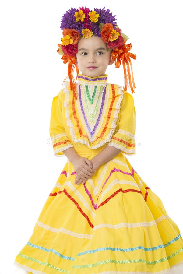 Traditional Mexican dress and hair piece. Beautiful little girl wearing colorful traditional Mexican dress and hair piece, white background royalty free stock photos